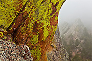 Rock formations seen beyond lichen covered rocks on the First Flatiron above Boulder, Colorado.