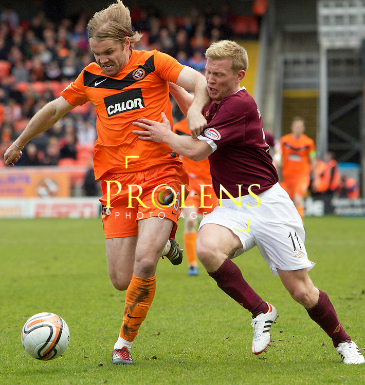 SPL Dundee United FC v  Hearts FC Scottish Premier League Season 2011-12.28-04-12...Dundee United's Robbie Neilson holds off Hearts Andy Driver      during the Scottish premier League clash between Euro spot chasing Dundee United FC and Heart of Midlothian FC...At Tannadice Stadium, Dundee..Saturday 28th April 2012.Picture Mark Davison/ Prolens Photo Agency / PLPA