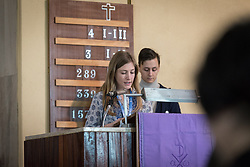 8 December 2019, Madrid, Spain: Lutheran World Federation delegate to COP25 Erika Rodning from the Evangelical Lutheran Church in Canada reads as Christians from around the globe gather with local congregants in the Iglesia de Jesús in central Madrid, to celebrate an ecumenical prayer service during COP25.