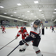 Kayla Mee, (front), is challenged by Victoria Bach, Boston University, during the UConn Vs Boston University, Women's Ice Hockey game at Mark Edward Freitas Ice Forum, Storrs, Connecticut, USA. 5th December 2015. Photo Tim Clayton