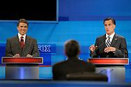Republican presidential candidate Texas Gov. Rick Perry, left, listens as former Massachusetts Gov. Mitt Romney makes a comment during a debate Thursday, Sept. 22, 2011, in Orlando, Fla. (AP Photo/Phelan M. Ebenhack, Pool)
