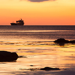 A ship on the Atlantic Ocean before sunrise, Rye, New Hampshire.