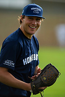 KELOWNA, CANADA - JUNE 28: NHL Vancouver Canucks player Luke Schenn smiles from the field during the opening charity game of the Home Base Slo-Pitch Tournament fundraiser for the Kelowna General Hospital Foundation JoeAnna's House on June 28, 2019 at Elk's Stadium in Kelowna, British Columbia, Canada.  (Photo by Marissa Baecker/Shoot the Breeze)