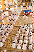 "10 MARCH 2006 - TAY NINH, VIETNAM: Noon Services at the main Cao Dai temple in Tay Ninh, Vietnam. The Cao Dai complex in Tay Ninh is the sect's headquarters. The Cao Dai religion is a blending of Buddhism, Confucianism, Taoism, Christianity and Islam. There ""saints""  include Chinese leader Sun Yat Sen and French author Victor Hugo. There are about two million members of the Cao Dai religion in Vietnam. British author Graham Greene, who wrote about the Cao Dai in the ""The Quiet American"" said the relegion was ""a Walt Disney fantasia of the East."" The Cao Dai pray four times a day - midnight, 6AM, noon, 6PM.  Photo by Jack Kurtz / ZUMA Press"