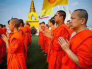 15 NOVEMBER 2018 - BANGKOK, THAILAND: Monks pray during the red cloth ceremony at Wat Saket, also called the Golden Mount. Wat Saket is on a man-made hill in the historic section of Bangkok. The temple has golden spire that is 260 feet high, which was the highest point in Bangkok for more than 100 years. The temple construction began in the 1800s during the reign of King Rama III and was completed in the reign of King Rama IV. A  red cloth (reminiscent of a monk's robe) is placed around the chedi at the top of  Golden Mount during the weeks leading up to the Thai holy day of Loy Krathong, which is November 22 this year.       PHOTO BY JACK KURTZ