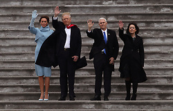 January 20, 2017 - Washington, District of Columbia, U.S. - US President DONALD TRUMP, first lady MELANIA TRUMP, Vice President MIKE PENCE and his wife KAREN PENCE wave goodbye to former President Obama and his wife Michelle as they depart on Marine One helicopter from the East Capitol steps during the trump inauguration in Washington. (Credit Image: © Gary Hershorn via ZUMA Wire)