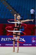Crijanovschii Ella during qualifying ribbon at the Pesaro World Cup April 14,2018. She is a rhythmic gymnastics athlete from Moldova.