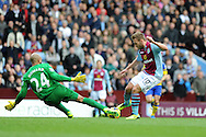 Aston Villa's Andreas Weimann is denied a goal by Everton keeper Tim Howard.   Barclays Premier League, Aston Villa v Everton at Villa Park in Aston, Birmingham on Saturday 26th Oct 2013. pic by Andrew Orchard, Andrew Orchard sports photography,