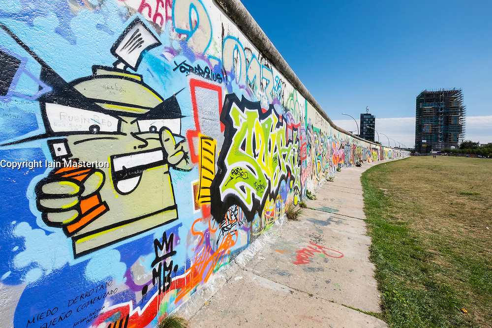 Graffiti on original section of Berlin Wall at the East Side Gallery in Friedrichshain Berlin Germany