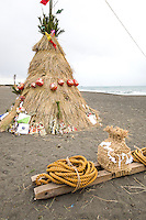 Every year in mid January, a  festival is held at Oiso Beach called Sagicho. Originally, local fishermen organized this event and tradition.  Sagicho has been observed for over 400 years and has been designated as Japan's national intangible treasures or officially Significant Intangible Folk Cultural Asset.  The Oiso no Sagicho is a Dosojin or a travelers' guardian deity fire matsuri.  Used shinto Japanese New Year decorations are turned into burnable artistic looking cones on the beach, and when the sun goes down, the bonfires are lit. Many local children participate by roasting dango, small glutinous rice cakes. Dango is eaten with the hopes of good health for the upcoming year.  From each group gathered around its respective bonfire, several men wear traditional loincloths and plunge into the frigid ocean. Straw cone shaped structures called Saito are built on the beach using pine, bamboo and New Year decorations.  These are turned into bonfires and provide some warmth for the participants and spectators.  This event is held during Koshogatsu, or Little New Year, the 15th of January.  Usually New Year decorations are taken down and burnt at the local Shinto shrine though Oiso is famous for burning them on the beach, with additional rituals associated with Koshogatsu.