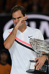 January 28, 2018: Number two seed Roger Federer of Switzerland poses for photographs with the trophy and sheds a tear after winning the Men's Final against number six seed Marin Cilic of Croatia on day fourteen of the 2018 Australian Open Grand Slam tennis tournament in Melbourne, Australia. Federer won 3 sets to 2. Sydney Low/Cal Sport Media(Credit Image: © Sydney Low/CSM via ZUMA Wire)