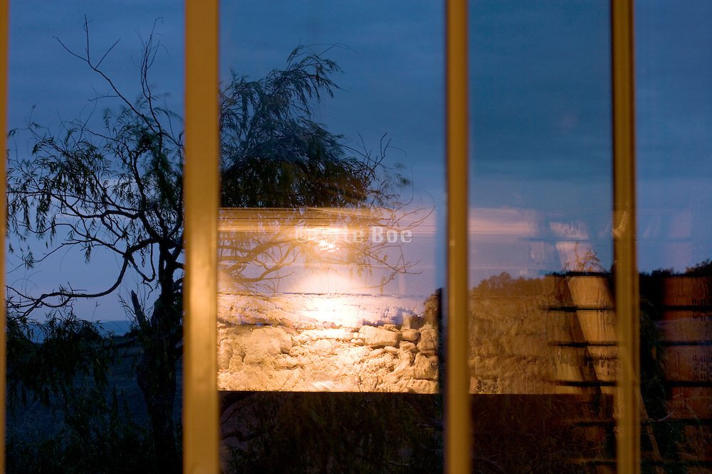 indoor light reflexting in wondow while outside it is getting dark