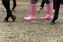 Channel four racing commentator's Derek Thompson, John Francome (far left) and John McCririck (hat) all sporting Thomas Pink wellington boots,2000. Photo By Andrew Parsons / i-Images