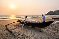 Fishermen at sunset, Talpona Beach, South Goa, India