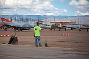 Laborer Jaysen Raymond pauses as construction crews at work building new runways at Holloman Air Force Base in Otero County. HAFB received over $21 million to upgrade various facilities as part of the Recovery and Reinvestment Act.