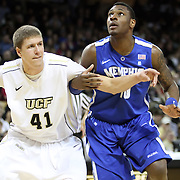 Central Florida center Tom Herzog (41) blockes out Memphis forward Tarik Black (10) during a Conference USA NCAA basketball game between the Memphis Tigers and the Central Florida Knights at the UCF Arena on February 9, 2011 in Orlando, Florida. Memphis won the game 63-62. (AP Photo: Alex Menendez)