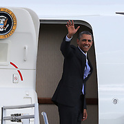 President Barack Obama boards Air Force One at the Orlando International Airport on Thursday, March 20, 2014 in Orlando, Fla., for a flight to Miami. (AP Photo/Alex Menendez)