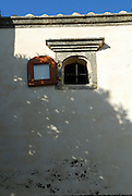 Detail of small carved window with shutter. Korcula old town, island of Korcula, Croatia.