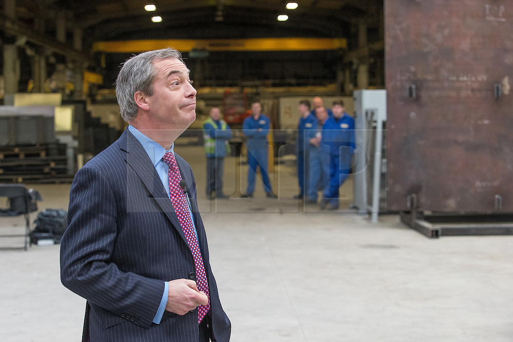 © Licensed to London News Pictures . 23/03/2015 . Middleton , UK . Nigel Farage arrives at the factory . UKIP leader Nigel Farage , Deputy Leader Paul Nuttall and Economics Spokesman Patrick O'Flynn announce UKIP's economic policy at Concept Metal Products and Co Ltd in Middleton , Lancashire . Photo credit : Joel Goodman/LNP