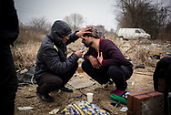 Migrants from Pakistan are seen shaving in a makeshift camp not far from the town of Subotica. They live in the woods with out water and electricity. Subotica, Serbia. March 18th, 2017. Federico Scoppa