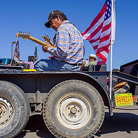 Albert McCork plays with the band Kool Country on a parade float during the 8th Annual All Veterans Gourd Dance in Twin Lakes Sept. 17.