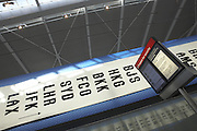 Baggage airport code advertising in landside Departures area newly-opened London Heathrow Airport's Terminal 5 building.