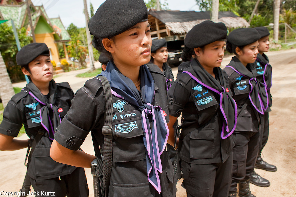 Sept. 29, 2009 -- BAAN TROKBON, THAILAND: Thai women Rangers drill at their base. The 39 women in the 44th Army Ranger Regiment are the only Thai women seeing front line active duty against Moslem insurgents in Thailand's deep south provinces of Pattani, Narathiwat and Yala. All of the other women serving in Thai security services are employed as office and clerical workers. The Ranger women are based at the Ranger camp in the Buddhist village of Baan Trokbon in Sai Buri district of Pattani province. The unit was formed in 2006 after Muslims complained about the way Thai soldiers, all men, treated Muslim women at roadblocks and during security sweeps. The women are frequently called upon to back up Thai regular army units when they are expected to encounter a large number of Muslim women. At least two of the women have been killed by Muslim insurgents. The unit has both Muslim and Buddhist members. Many of the women in the unit joined after either their fathers or husbands were killed by insurgents.    Photo by Jack Kurtz / ZUMA Press