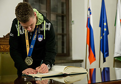 Zan Rant Roos signing the City of Ljubljana's Golden Book during reception of Slovenian National Handball Men team after they placed third at IHF World Handball Championship France 2017, on January 30, 2017 in City hall, Ljubljana centre, Slovenia. Photo by Vid Ponikvar / Sportida
