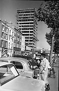 The new skyscraper Liberty Hall, now reaching it 17th and final storey. In the foreground a Dublin car attendant has his regular afternoon meal..26.09.1963