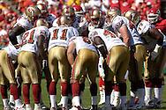 San Francisco 49ers quarterback Alex Smith (11) huddles with his teammates against Kansas City at Arrowhead Stadium in Kansas City, Missouri October 1, 2006.  The Chiefs beat the 49ers 41-0.