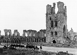 Undated file photo of British troops with mules and a wagon in front of the ruins of the mediaeval Cloth Hall in Ypres, Belgium, at the end of the First World War. Theresa May, the Prince of Wales and the Duke and Duchess of Cornwall will join the descendants of soldiers who fought at the Battle of Passchendaele at events in Belgium on Sunday and Monday to mark 100 years since the start of one of the bloodiest campaigns of the war.