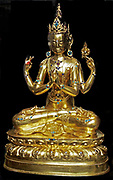Gilt and lacquered bronze figure of Amitabha Buddha seated on a lotus base on a tiered throne, with a mandorla behind.  Ming dynasty, 16th-17th century AD.