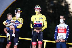 Jumbo Visma's rider Primoz Roglic and UAE Emirates's rider Tadej Pogacar winner of the yellow jersey of overall winner and Trek Segafredo's rider Richie Porte on the podium of the Tour de France 2020, on Champs Elysees Avenue in Paris, on September 20, 2020. / Sportida