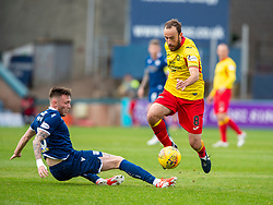 Dundee's Jordan McGhee and Partick Thistle's Stuart Bannigan. half time : Dundee 1 v 0 Partick Thistle, Scottish Championship game player 19/10/2019 at Dundee stadium Dens Park.
