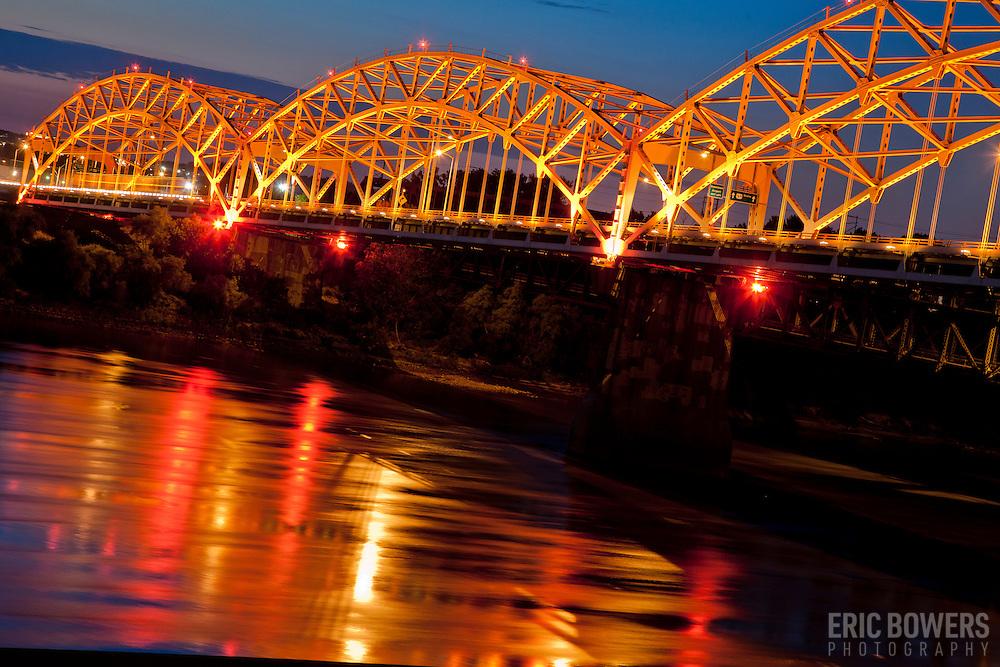 Broadway Bridge illuminated over the Missouri River at dusk in Kansas City MO.