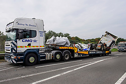 © Licensed to London News Pictures. 26/08/2017. Milton Keynes, UK. Remains of the minibus (left, NOTE: minibus is in two pieces) and a lorry (right) involved in the crash, are removed from the M1 motorway near Milton Keynes. Police say that several people are dead and four others have been taken to hospital after the accident on the southbound carriageway in the early hours of this morning. Photo credit: Ben Cawthra/LNP