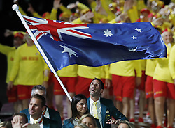 Australian flag bearer Mark Knowles leads the team out during the Opening Ceremony for the 2018 Commonwealth Games at the Carrara Stadium in the Gold Coast, Australia.