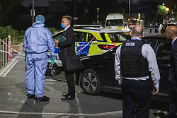 © Licensed to London News Pictures. 31/05/2021. London, UK. Police investigators at the crime scene at Montrose Park, Edgware following the fatal stabbing of an 18-year-old male. Metropolitan Police were called at 17:54 BST on Monday 31/05/2021 following reports of a group of males fighting. The man was found suffering from a stab injury in a tennis court area. He was treated by London's Air Ambulance and London Ambulance Service at the scene but was pronounced dead at 19:19 BST. Photo credit: Peter Manning/LNP