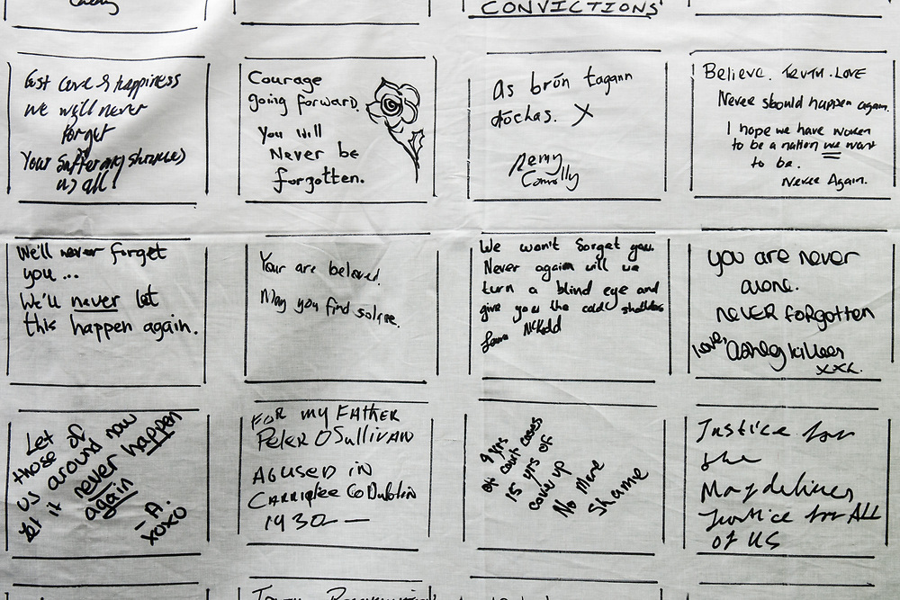 """Dublin, Ireland. 26th August, 2018. <br /> Messages are left by the participants at the end of the silent march of the Stand4Truth protest at the sites of previous laundries, in Sean Macdermott Street Lower, during the Holy Mass of the second of the two-days of the visit of Pope Francis in Dublin, Ireland.<br /> Pope Francis has made a two-day visit to the Republic of Ireland by celebrating a Mass at Dublin's Phoenix Park. The Argentine Pope asked forgiveness for the """"abuses in Ireland, abuses of power, conscience and sexual abuses"""" perpetrated by Church leaders. It was the first papal visit to Ireland for 39 years. During his activities many activists, victims and survivors have made protests and a silent march Garden of Remembrance towards the last Magdalene Laundry to close in Ireland.<br />  © Simone Padovani"""
