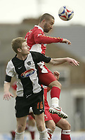 Photo: Aidan Ellis.<br /> Grimsby Town v Swindon Town. Coca Cola League 2. 17/03/2007.<br /> Swindon's Christian Roberts gets up above Grimsby's Danny Boshell to win the header