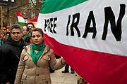 Protesters shouting slogans in front of their banners and flags. Stop The War Coalition rally outside the US Embassy in London. Scuffles broke out during the protest, as opposite sides of the arguement shouted each other down. The protest is in response to inflamatory language being used by the US and UK concerning Iran and Syria. Free Iran supporters were came in strong numbers, to listen to speakers.