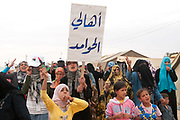 Tunisia 2011. Remada camp for refugees from Libya. After Friday prayers refugees (mostly mothers and children) held a demonstration around the camp. One of the chants was 'We don't want milk for our children we want guns for our fighters'.