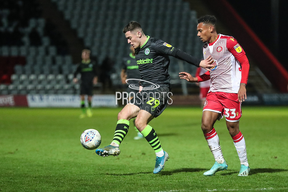 Forest Green Rovers Jack Aitchison(29), on loan from Celtic holds off Stevenage's Tyler Denton(33) during the EFL Sky Bet League 2 match between Stevenage and Forest Green Rovers at the Lamex Stadium, Stevenage, England on 26 December 2019.