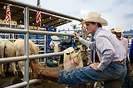 Cole Taylor, a 22 year-old bullrider from Sayre, OK stretches before the rodeo.