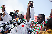 Convention People's Party (CPP) presidential candidate Paa Kwesi Nduom (left) holds hands with running mate Abu Sakara Forster (right) during a rally in Accra, Ghana on Sunday September 21, 2008.