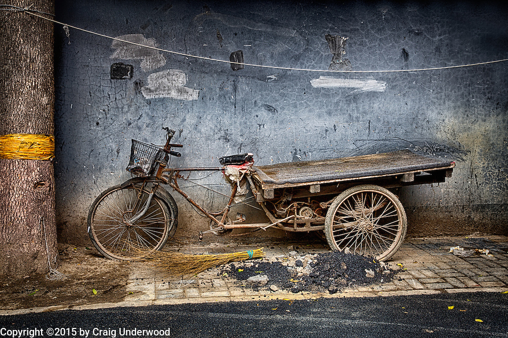 Late one afternoon I was walking the back streets of Beijing, China looking for street scenes to shoot.  I came across this bike and was fascinated by the story it tells.  While it looks to be unusable now, you can tell it has been parked in the same location many times before as the back bed scraped the wall numerous times.