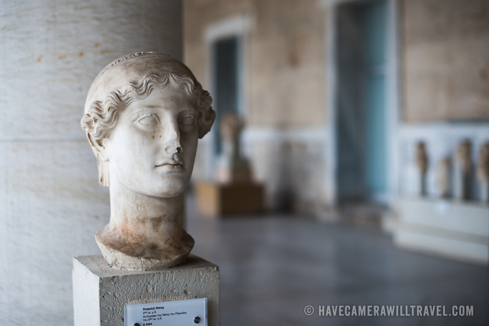 Head of Victory. 2nd century AD. Copy of the Nike by Paionios of the 5th century BC. The Stoa of Attalos is a 1950s recreation of a long pavilion that was originally built around 150 BC. It was part of the Ancient Agora (market). It now houses the Museum of the Ancient Agora, which includes clay, bronze and glass objects, sculptures, coins and inscriptions from the 7th to the 5th century BC, as well as pottery of the Byzantine period and the Turkish conquest.