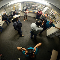 060314  Adron Gardner/Independent<br /> <br /> The distortion of a security camera bubble reveals a crowd awaiting election returns late Wednesday evening at the McKinley County Courthouse in Gallup Wednesday.