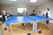The games room at Pickwell Manor, Georgeham, North Devon, UK. From left to right: Milly-grace Elliott (8), Molly Elliott (10), Liza Baker (9). <br /> CREDIT: Vanessa Berberian for The Wall Street Journal<br /> HOUSESHARE