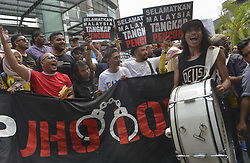 April 14, 2018 - Kuala Lumpur, Kuala Lumpur, Malaysia - Protester holds a placard  during a 'Nab A Thief' Jho Low rally in Kuala Lumpur. The rally is being held to call for the arrest of businessperson  Jho Low. (Credit Image: © Kepy via ZUMA Wire)